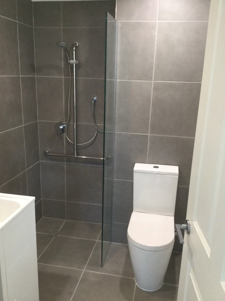Sparkling new bathroom includes zero transition flooring, anti-slip tiles and built-in grab rail