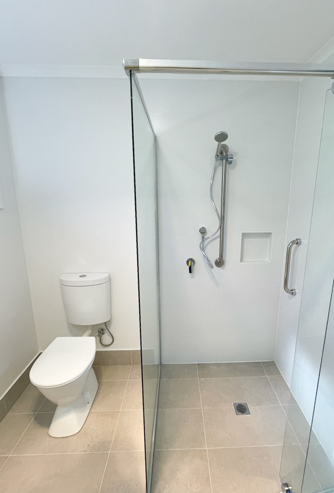 Renovated bathroom complete with zero transition flooring